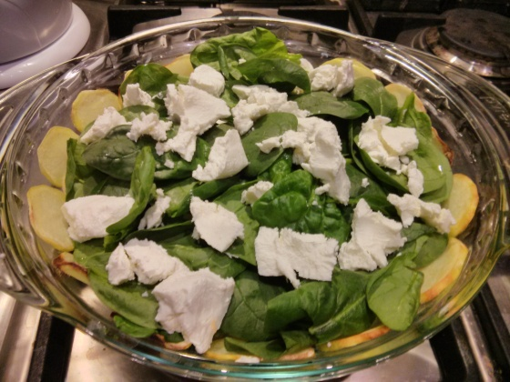 Next the spinach and goat cheese are added