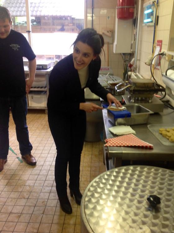 Hannah cutting her waffle in half!