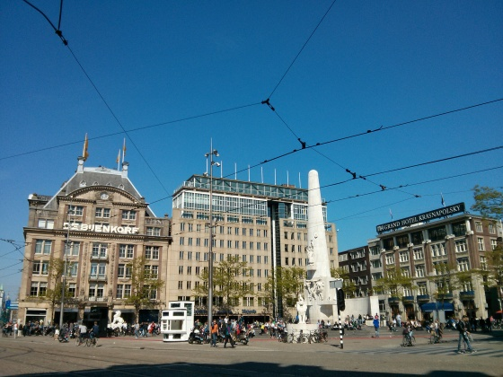 Dam Square, with the National Monument and De Bijenkorf (luxury department store) in view