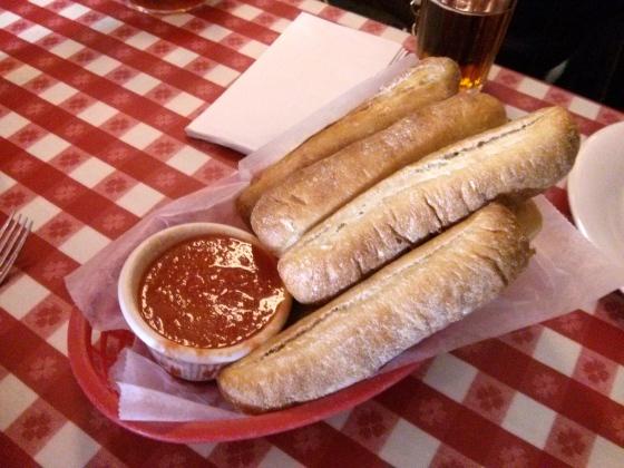 Breadsticks with marinara sauce as a starter