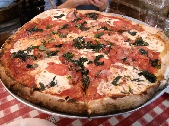 Our delicious pizza with sauteed spinach, tomatoes, and prosciutto