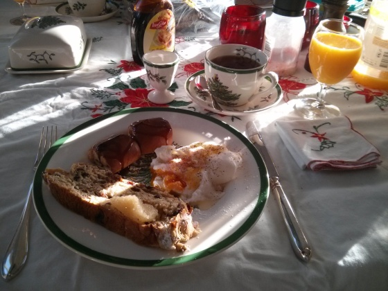 Poached egg, sausage rolls, and a slice of Kerststol!