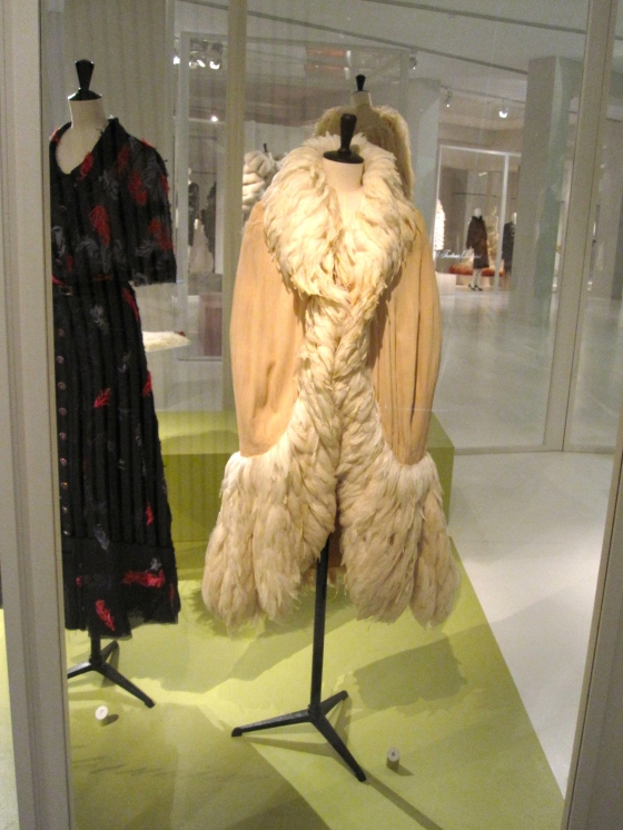 Chanel, Haute Couture Spring-Summer 1925; Cape in silk crepe, decorated with very fine pleats, trimmed with rooster feathers