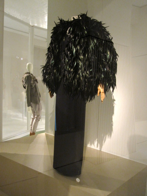 Yves Saint Laurent, Haute Couture Autumn-Winter 1996-1997; Evening ensemble of jacket with rooster feathers and dress in silk jersey