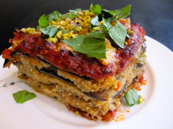 Eggplant lasagne topped with pistachios and basil