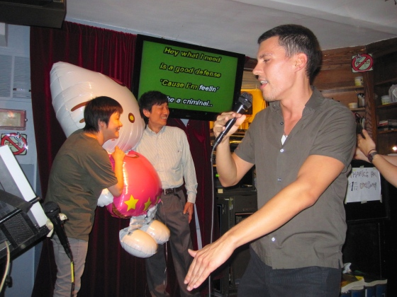 Our karaoke masters taking photos with Hello Kitty while Danny sings