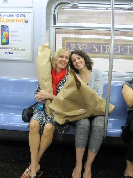 Annette and Ashley on the subway with the flowers