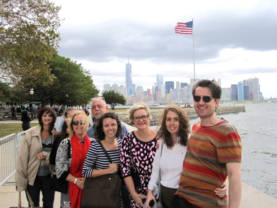Group Photo on Ellis Island with Manhattan in the background