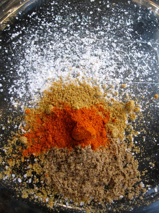 Making the rub for the chicken - salt, cumin, coriander, and cayenne pepper