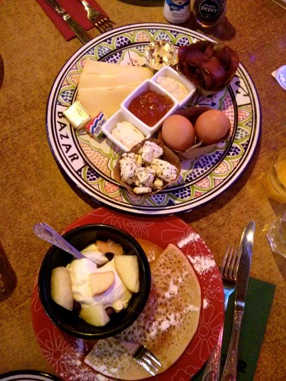 Pide, açma and simit, marinated feta cheese, seasoned cream cheese, kaymak (clotted cream), apricot jam, honey, thousand holes pancake, fresh fruit yoghurt, boiled egg, at Hotel Bazar