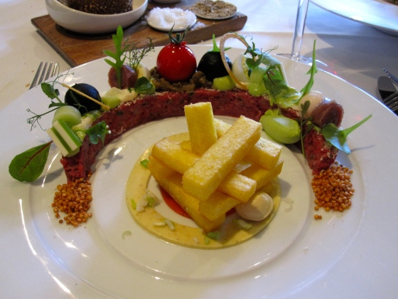 Steak tartare with micro-vegetables and foie gras cream served with fries