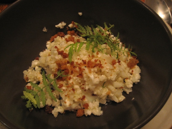 5: Cauliflower couscous cooked in chicken fat with sourdough crumble and marigold leaves topped with a slow poached egg