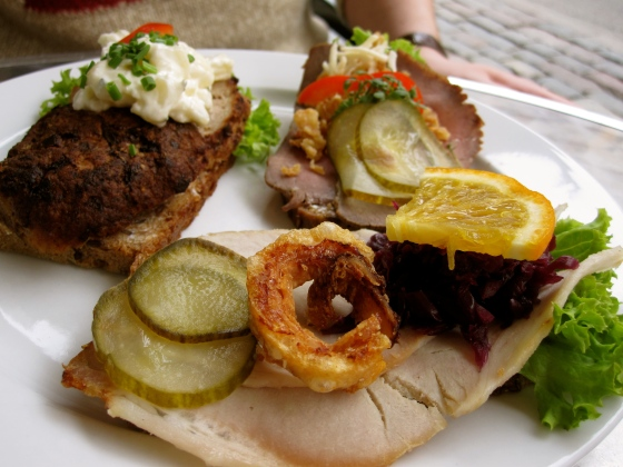 Koen's smørrebrød: special Danish pork topped with pork rind, meatball with potato salad, and roast beef with fried onions