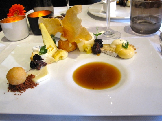 "Cheese selection ""Kaasmeester Van Tricht en Zoon"": 18 cheeses served with chutney, goat cheese ice cream, onion broth, and bread"