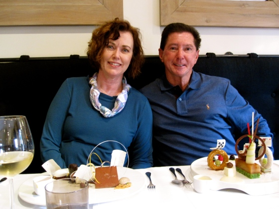 Mom and Dad with their desserts