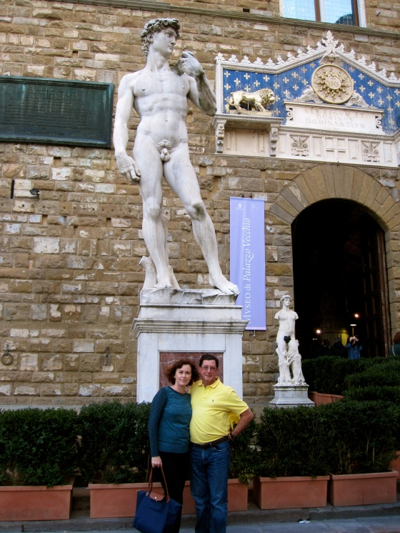 Mom and Dad with the copy of Michelangelo's David statue in front of the Palazzo Vecchio