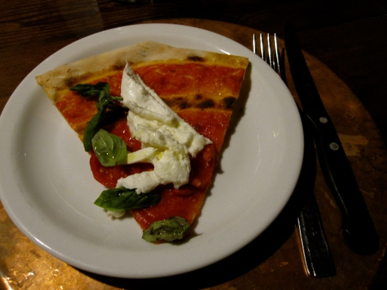 A piece of the margherita with mozzarella