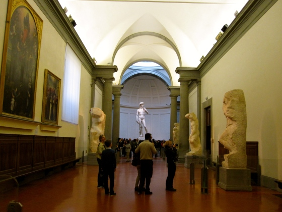 The hallway displaying The Prisoners, leading to David