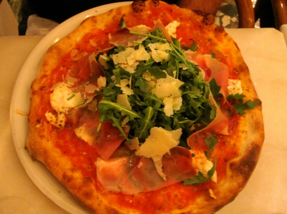Dad's Orso pizza: tomato sauce, buffalo mozzarella, cherry tomatoes, Italian smoked ham, rucola, basil, and parmesan